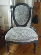 the finshed chair, studded with antique brass strips